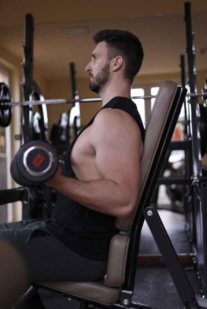 man in black tank top and black shorts working out
